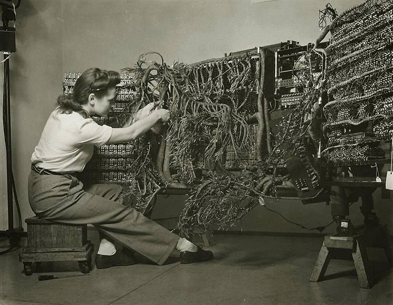 Berenice Abbott- Woman wiring an early IBM computer